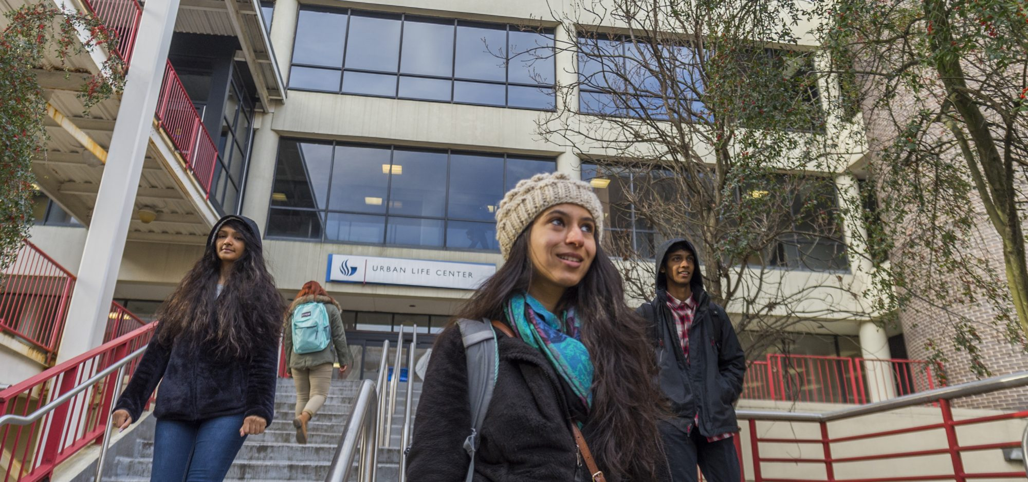 Students walking outside the Urban Life Building